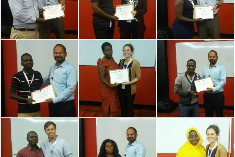Workshop attendees receiving their certificates of completion.